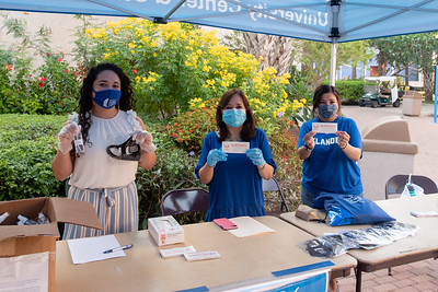 TAMU-CC staff hand out masks and promo items during the first day of the Fall 2020 semester.