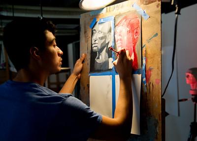 Student Jamie Gonzalez paints his second study of his object.