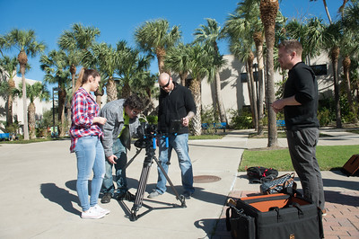 Mariela Navarro (left), Brant Cloyd, and Charles Gonzalez set up a video camera with guidance from professor Nick Manley during their Production 2 class.