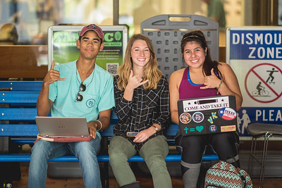 Tarik Whitmore (left), Anna Bachman, and Victoria Flores take a break during the day in the breezeway.