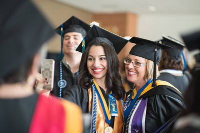 ElexisSaenz and Julie Fomenko after the College of Nursing and Health Sciences hooding recognition ceremony.  View more photos: http://bit.ly/1O6mJ2T