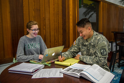 Students and ROTC cadets Matthew Connell and Anissa Sardelich study together in the Faculty Center.