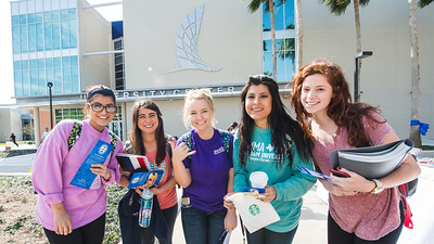 Leticia Salinas (left), Lauren Rodriguez, Faith Stevens, Kathleen, and Amanda Slovak pose for a photo in front of the University Center.