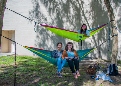 Leah Bernhardt (left), Mikaylee Polk, and Stephanie Flores (top) enjoy their break in front of the Center for Instruction.