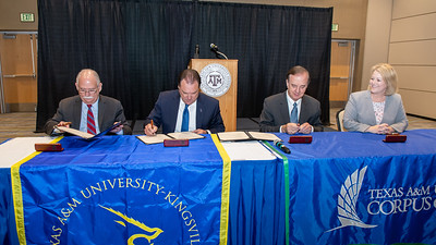 """President and CEO of Texas A&M-Kingsville Dr. Steve Tallant (left), Commissioner Henry """"Hank"""" Whitman, Jr., Texas A&M University System Chancellor John Sharp, and President and CEO of Texas A&M University - Corpus Christi, Dr. Kelly Quintanilla"""