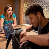 Raven Martinez (left), and Franklin Campos work on their biology studies in the Momentum Village club house.