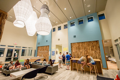 Students unwind in the Momentum Village club house.