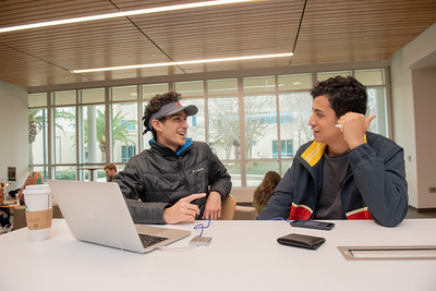 Students Gerardo Nasser(left), and Hamza Mohammad catch up on the first day of the Spring 2019 Semester.
