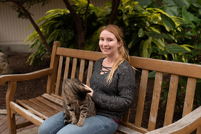 Student Shannan McAskill interacts with a cat on campus on the first day of the Spring 2019 Semester.