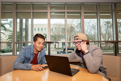 Austen Molina (left), and Dillon Curd hang out in the Tejas Lounge during the first day of the Fall 2019 Semester.