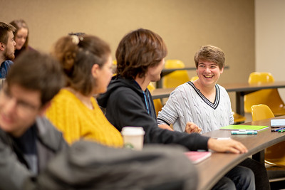 Student Mary Cazes catches up with fellow classmates on the first day of the Spring 2019 Semester.