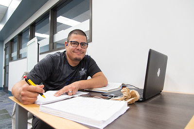 Jay Cano is working on his Engineering Analysis work at the Mary and Jeff Bell Library.