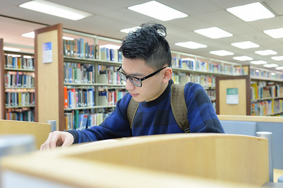 Bao Nguyen is studying at the Mary and Jeff Bell Library.