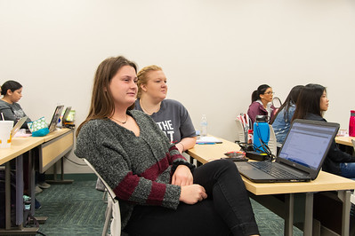 Taylor Knapp(left) is listening to the instructor in her Transitions course during the first week of school.