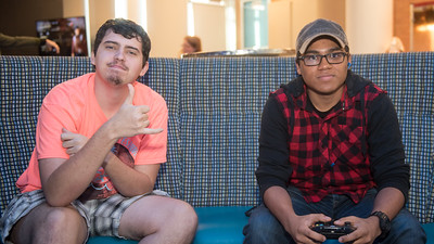 Students Kyle Justus and Bryce Gardner take a break from playing a video game to pose for a photo.