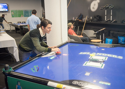 Diego Vado plays air hockey in the Breakers Game Room