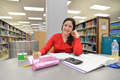 Paula Villalpando working on her math assignments at the Mary and Jeff Bell Library.