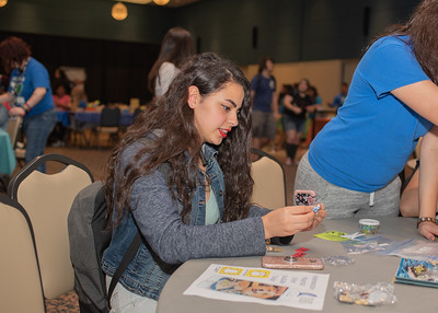 Zeina Nader blows off steam while making a lego character during Paws on the Island.