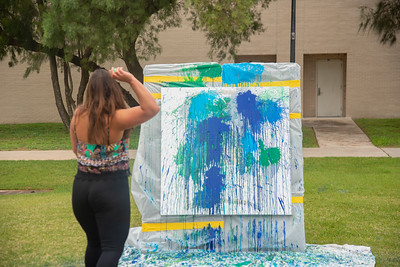 Leticia Cardenas relieves some finals stress on East Lawn.