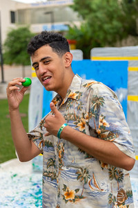 Hamza Mohammad prepares to throw paint to relieve finals stress.