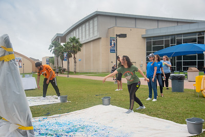Students relieve stress on East Lawn by throwing paint.