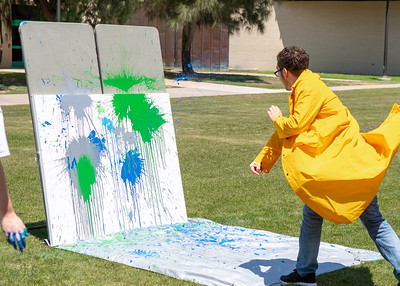 "Islander students relieve their stress of finals by throwing paint at a canvas during ""Paint Explosion"" as part of the Finals Week events."
