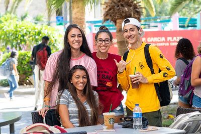 Saige Martinez (left), Paula De Jesus, Talor Appel, and Raine Martinez (bottom row) grab refreshments and lounge at the Starbucks patio.