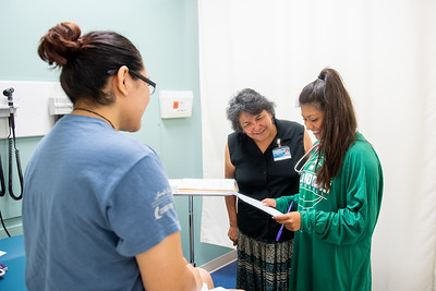 Professor Carmen Hernandez assists Aliciana Mireles and Amber Merla with their nursing lab.
