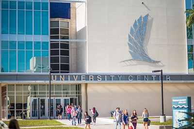 Islanders walk through Anchor Plaza as they make their way to and from the University Center.