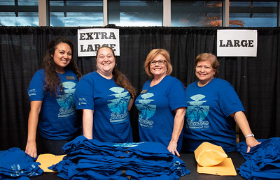 Kristeen Gonzalez (left, Alison Marks, Debbie Busey, and Nancy Salinas come out as apart of the Universitys faculty to distrubute free t-shirts to students for Isalnders NIght Out.