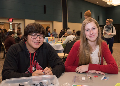 Cristian Escobedo (left) and Abbi Tyler relieve their stress by playing with legos during Paws on the Island.  Check out more events happening during finals week: https://adobe.ly/2BOQZ4n