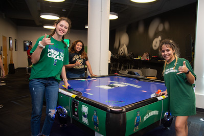 Hanna Ragnar (left), Angelica Velasquez, and Erica Diaz play air hockey at Breakers room located inside the University Center.
