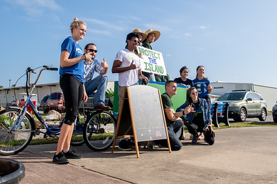 The Islander Green team gathers for a photo with the new Bike and Trailer used to haul compost.