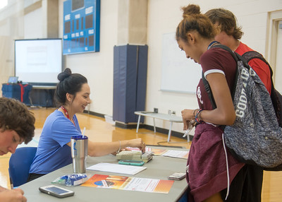 Marcelina Garza checks in students for the Coastal Bend Heart Walk Kickoff.