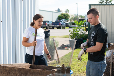 Students Melissa Zamora (left), and Mark Rolph volunteer at the Islander Green Garden.