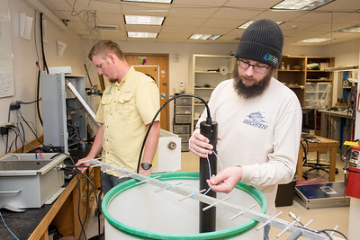 Research Engineer Associates Brian Lorentson (left), and Hugo Mahlke perform tests to the X-Lite module prior to installment.