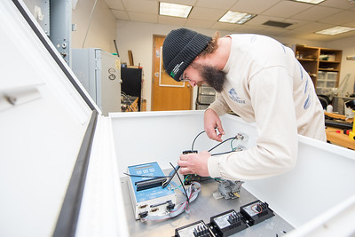 Research engineer associate Hugo Mahlke works on testing and assembling an X-Lite module prior to installing it on site.