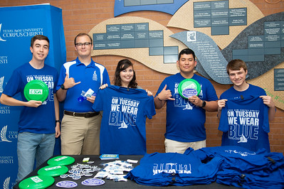 Members of the Student Government Association promote Bluesday Tuesday by handing out T-shirts in the University Center Tejas Lounge.