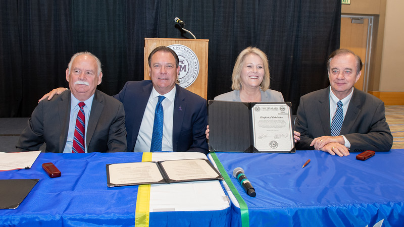 """President and CEO of Texas A&M-Kingsville Dr. Steve Tallant (left), Commissioner Henry """"Hank"""" Whitman, Jr., Texas A&M University System Chancellor John Sharp, and President and CEO of Texas A&M University - Corpus Christi, Dr. Kelly Quintanilla after signing the Certificate of Collaboration for the Supervised Independent Living Program."""