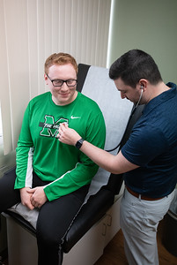 Dathan Jobe (BSN '15, MSN '21) checks the heart rate of his patient (Drew Lauhon).