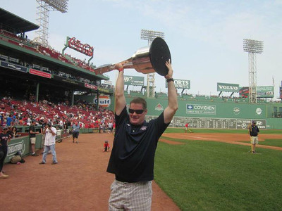 alumni lacrosse story  Steve Duffy holds the Major League Lacrosse championship trophy at Fenway Park during a Red Sox pregame ceremony honoring the Boston Cannons.