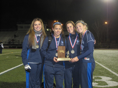 Fall sports review photo:  The senior members of the Westfield State University women's soccer team hold the conference championship trophy: Left to right are: Ashley Kulik, Madison Farrell, Heather Dragon, and Kate Wye.