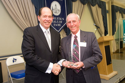 photo for William Miller Hall of Fame feature story:  William Miller ('53), right, receives the prestigious James C. Hagan award from Westfield State University President Evan S. Dobelle during the Athletics Hall of Fame Banquet.