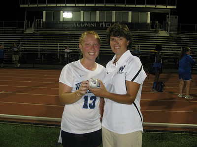 Fall sports review story:  Westfield State University field hockey head coach Heather Cabral ('92) awards the game ball to senior Jessi Gould after she scored her 100th career point