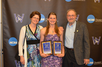 Amanda Gricus, with her parents Patricia and Charles Gricus, was the Massachusetts State Collegiate Athletic Conference Female Scholar-Athlete of the Year and an Academic and NCAA All-American.
