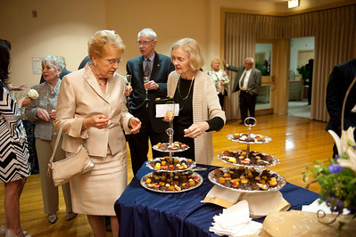 Longtime foundation members Barbara Braem-Jensen and Susan Greaney '64 enjoy champagne and chocolates in the newly named Loughman Living room.  Judge John Greaney is in the background.  (I'd crop to the three people pictured at center, keeping the chocolates tray in the image)