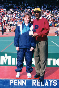 Possible good photo for Janice Beetle history of athletics article. Westfield State's Claudine Rice (Class of 1995) receives the medal from comedian Bill Cosby - an avid sports fan who resides in Western Mass. - for placing first in the hammer throw at the 1995 Penn Relays. Rice also won the NCAA hammer thrown national championship in 1994.