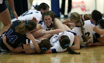 The Westfield State women' s volleyball team celebrates after winning its second straight MASCAC championship.