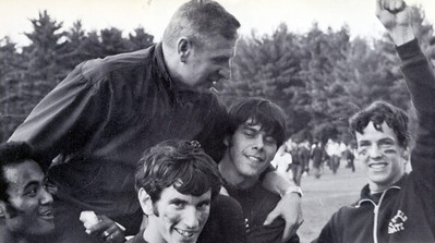 COACH JOHN KURTY PHOTO:  Coach John Kurty is carried off the field after the Owls captured the New England state colleges championship in 1970. Westfield finished the season with a spectacular 15-1-1 record.