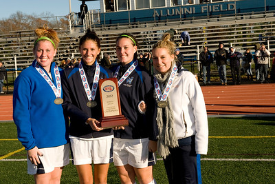 Photo for Westfield State women's soccer feature story:  Westfield State University women's soccer team senior captains receive the Massachusetts State Collegiate Athletic Conference championship trophy. Left to right are: Colleen Bazinet, Brittanie McGregor, Kayley Miller, and Leann Rivard.